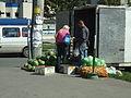 Melon and vegetable seller (3105485608).jpg