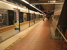A Blue Line train is stationed on the B1 level of 7th Street/Metro Center Station, its terminus.