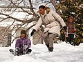 Michelle Obama and her daughters in the snow (cropped).jpg