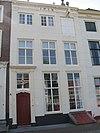 foto van Pand met gepleisterde rechte gevel, half woonhuis, half pakhuis