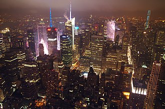 Architecture of New York City - The Midtown Manhattan skyline at night from the Empire State Building. Shown are clear examples of Art Deco and Modern architecture.