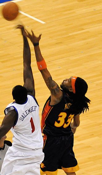 Mikki Moore - Moore competes for a jump ball with Samuel Dalembert in 2009.