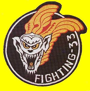 "VF-33 - The VF-33 Tarsiers patch featuring ""Minky"", a Tarsier monkey."