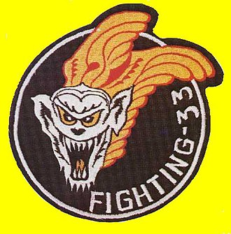 """VF-33 - The VF-33 Tarsiers patch featuring """"Minky"""", a Tarsier monkey."""