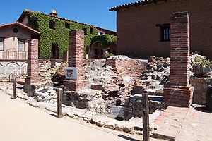 "Spanish missions in California - A view of the Catalan forges at Mission San Juan Capistrano, the oldest existing facilities (circa 1790s) of their kind in the State of California. The sign at the lower right-hand corner proclaims the site as being ""...part of Orange County's first industrial complex."""