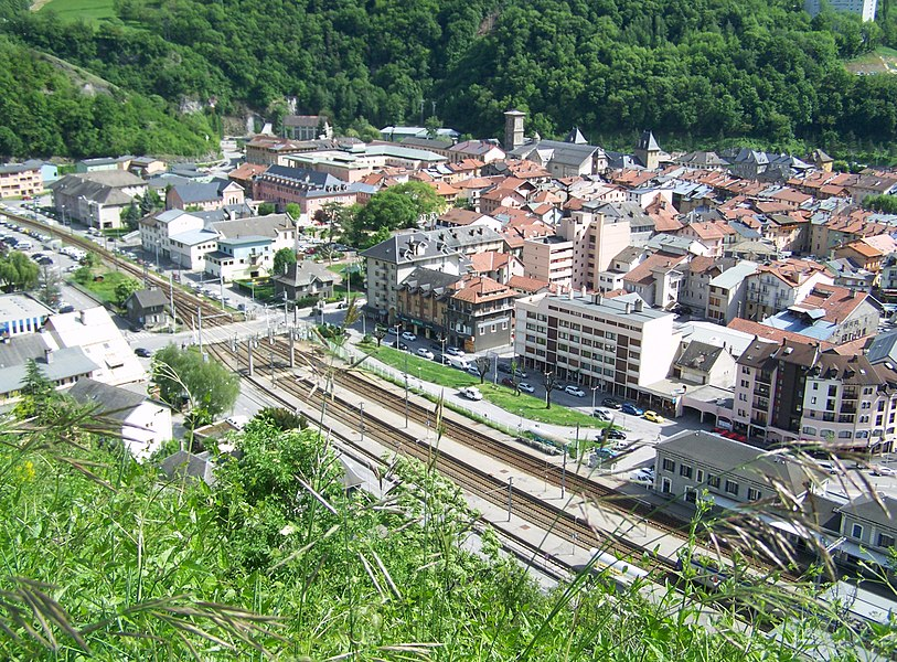 Sight on city of Moûtiers, its railway station and the Tarentaise railway line in Savoie, France.