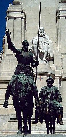 Don Quijote-Denkmal in Madrid, im Hintergrund sein Schöpfer Cervantes