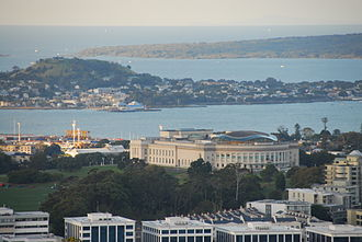 Auckland War Memorial Museum - The museum seen from Maungawhau / Mount Eden, showing the wavy shape of the copper dome.
