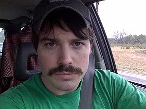 English: Man with short, dark mustache.