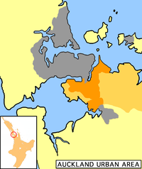 Manukau City (in orange) within the Auckland metropolitan area. The darker orange indicates the urban area.