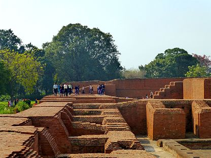 Nalanda - 037 People on Monastic Ruins (9250761121).jpg
