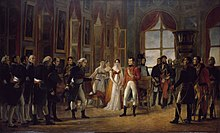 Peinture représentant Napoléon en tenue de consul, debout au centre d'une pièce, entouré de Joséphine de Beauharnais et de plusieurs dignitaires, alors que Cambacérès lui tend un document d'un air révérencieux.