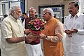Narendra Modi being welcomed by the Chief Minister of Haryana, Shri Manohar Lal Khattar, on his arrival, at Faridabad. The Governor of Punjab and Haryana and Administrator, Union Territory, Chandigarh.jpg
