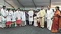 Narendra Modi with the workers of Shri Venkateswara Mobile & Electronics Manufacturing Hub, in Tirupati, Andhra Pradesh. The Union Minister for Urban Development.jpg