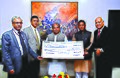 Narendra Singh Tomar received on behalf of the Government of India the first interim dividend cheque for Rs.951.58 crore for the year 2014-15 from the Chairman-cum-Managing Director of NMDC Limited.jpg