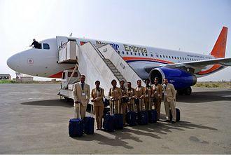 Nasair - Nasair staff and an Airbus A320.