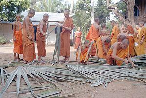 Literature of Laos - Novice monks practicing the art of making palm-leaf folios at Wat Manolom, Luang Prabang, Laos