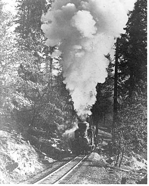 Yosemite Mountain Sugar Pine Railroad - A Madera Sugar Pine Lumber Co. log train climbing a steep grade near Sugar Pine, California, circa 1915.