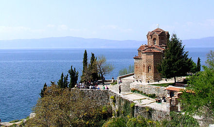 The 13th-century church of St. John at Kaneo and the Ohrid Lake in North Macedonia. The lake and town were declared a World Heritage Site by UNESCO in 1980. Ohrid Lake.jpg