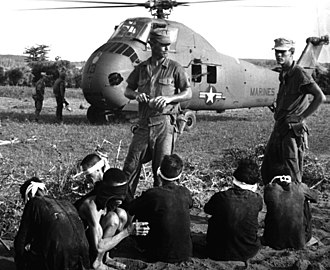 Operation Starlite - Vietcong prisoners await being carried by helicopter to rear area after Operation Starlite.