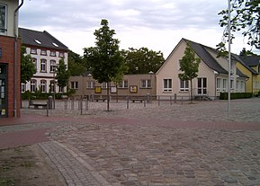 New commune center with the town hall in the background