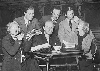 Otto Preminger -  Preminger (sitting) with (left to right) Liane Haid, Rosy Barsony, Oskar Karlweiss, Paul Abraham and Tibor Von Halmay in 1934.