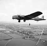 Parachute troops jump from a Whitley bomber during a demonstration for the King near Windsor, 25 May 1941. H9955.jpg