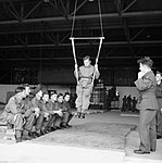 Paratroopers learn to land correctly using a special harness at RAF Ringway, August 1942. H22867.jpg