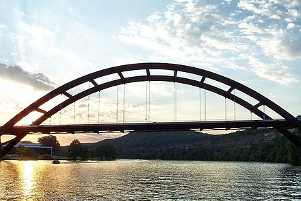 The Pennybacker Bridge is the signature element of Loop 360 in the Texas Hill Country. Pennybacker bridge sunset 2006.jpg