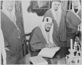 Photograph of Crown Prince Amir Saud of Saudi Arabia signing the guest book at Mount Vernon, as other Saudi Arabian... - NARA - 199526.tif