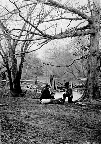 Photographers of the American Civil War - Photographers E.T. Whitney and an assistant having lunch at the destroyed, temporary Confederate R.R. spur near Mitchel's Ford in March 1862.
