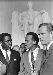 Belafonte (center) at the 1963 Civil Rights March on Washington, D.C with Sidney Poitier and Charlton Heston.