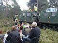 Polisens bandvagnar under protesterna i Ojnareskogen.jpg