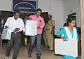 Polling officials carrying the Electronic Voting Machines (EVMs) and other necessary inputs required for the Kerala Assembly Election, at the distribution centre, in Nemom, Thiruvananthapuram on May 15, 2016.jpg