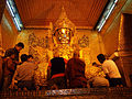 Prayers and gold leaf being applied by devotees Buddhist culture religion rites rituals sights.jpg