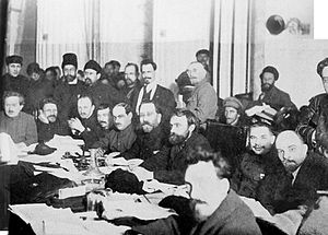 Bolsheviks - 1920 Bolshevik Party meeting. Sitting (from left): Enukidze, Kalinin, Bukharin, Tomsky, Lashevich, Kamenev, Preobrazhensky, Serebryakov, Lenin and Rykov