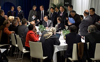 2009 United Nations Climate Change Conference - India's Prime Minister Manmohan Singh (blue) and Indian Minister of Environment and Forests Jairam Ramesh (behind) during a multilateral meeting with U.S. President Barack Obama, Chinese Premier Wen Jiabao, Brazilian President Lula da Silva and South African President Jacob Zuma at the United Nations Climate Change Conference.
