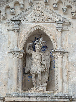 Sanctuary of Monte Sant'Angelo - Statue of Saint Michael overlooking the entrance of the Sanctuary.