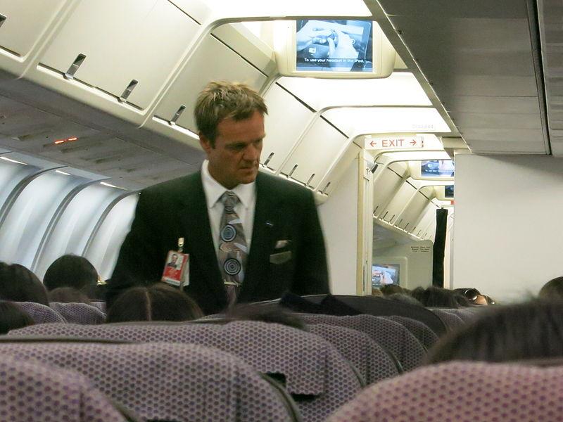 File:Qantas flight attendant.jpg