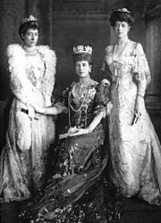 Alexandra with her daughters Victoria (right) and Louise (left)