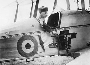 No. 16 Squadron RAF - An observer of the Royal Flying Corps in a Royal Aircraft Factory B.E.2c reconnaissance aircraft demonstrates a C type aerial reconnaissance camera fixed to the side of the fuselage, 1916