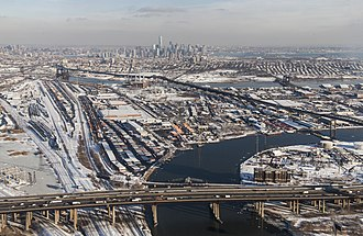 Pulaski Skyway - Looking east with almost the entire skyway in the background from the Passaic River to its terminus in Jersey City; New Jersey Turnpike in the foreground