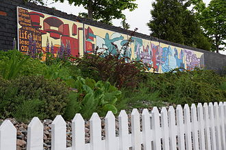 Reddish South railway station - Local campaigners have installed artwork, a flower-bed and a fence alongside the platform