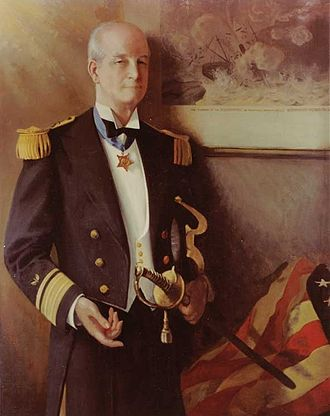 Richmond P. Hobson - Painting of Rear Admiral Richmond P. Hobson (Retired), dated 1937. He is depicted wearing his Medal of Honor and standing before an artwork of the sinking of the USS Merrimac.