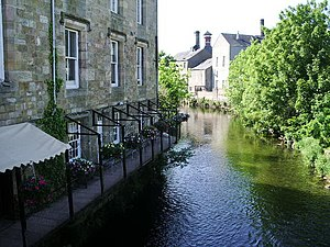 Cockermouth - River Cocker with the walkway attached to the building