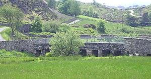"Roman Bridge railway station - The ancient ""Roman Bridge"" across the upper Afon Lledr"