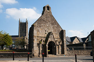Roscrea - Surviving west gable of the 12th-century Romanesque Church with the Anglican parish church in the background.