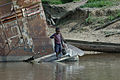 Rusty vessel beached on the Congo River.jpg