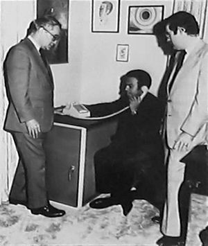 STU-I - STU-I cabinet with desk set on top. The person talking is U.N. Ambassador Andrew Young, calling from New York City during the Israel-Egypt peace talks in the Carter administration.