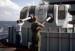 Sailors clean gun barrels aboard USS Pyro (AE-24), 1 November 1986 (6421830).jpg